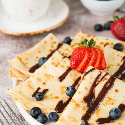 homemade-thin-pancakes-with-berries-chocolate